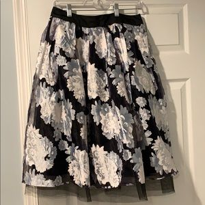 Knee length floral skirt with tule